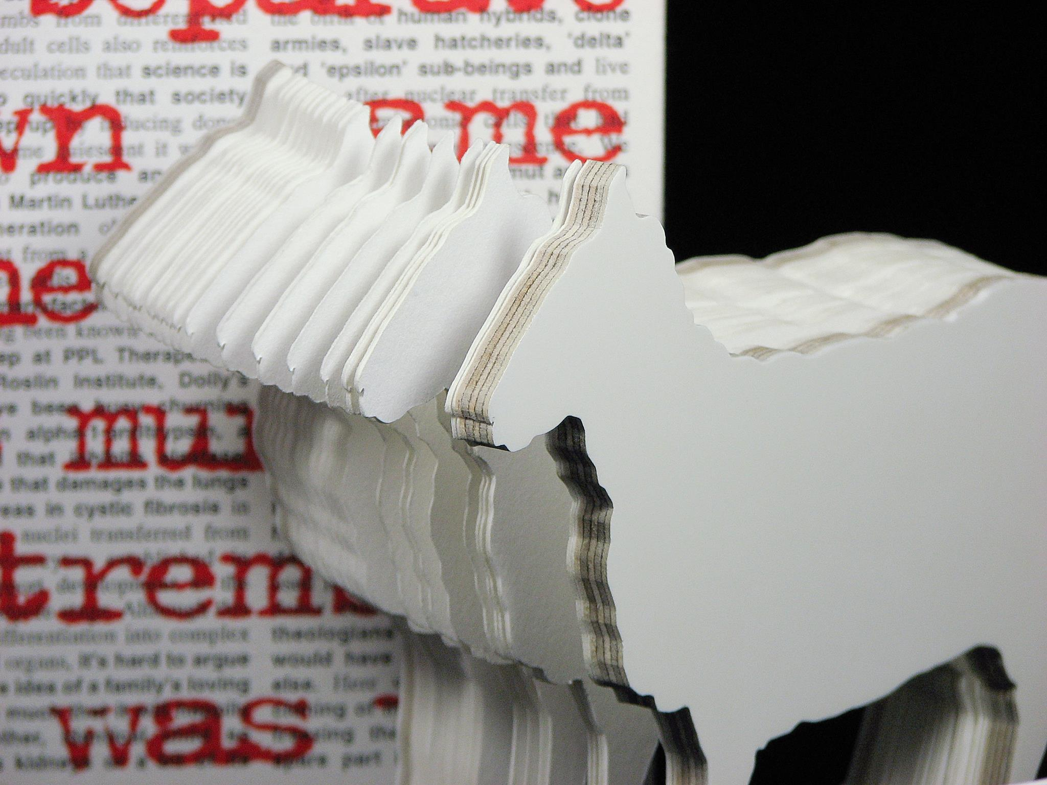 Close up view of artist book Dolly: Edition Unlimited by Karen Bleitz, a pop-out jig-sawed book-work on the theme of the cloned sheep, Dolly, with a freestanding herd of sheep integrated into the form of the book.